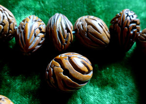 A String of Antique Carved Nut Beads