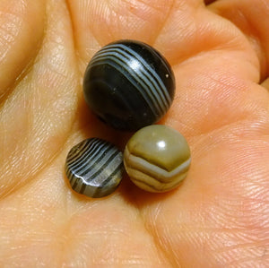 A collection of 3 Banded Agate Beads