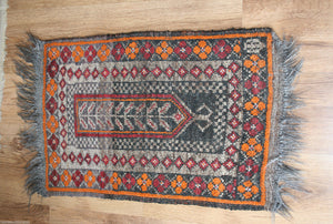 An Antique Early 20th C Turkoman Woolen Belouch Prayer rug