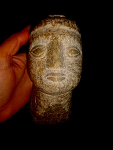An Archaic Carved Marble Head of a Youth