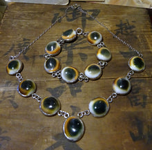 A Set Of Operculum Silver Necklace & Bracelet