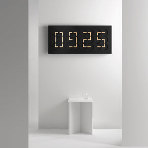 ClockClock 24 black with golden hands by Humans since 1982. Clock Clock is a kinetic sculpture and functioning wall clock.