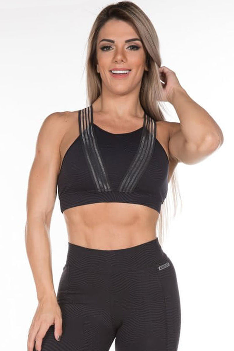 Emana Black sports bra with clear elastic band application.