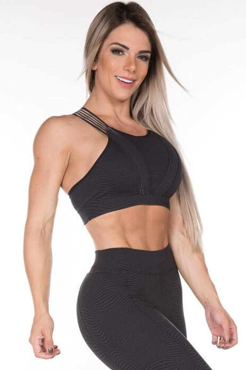 support and high compression sports bra with clear elastic band application.