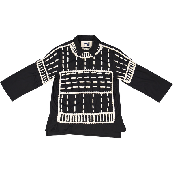 Mii Black and white embroidered wool dash top