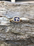 Hexagon ring with fleur de lis and simulated stone