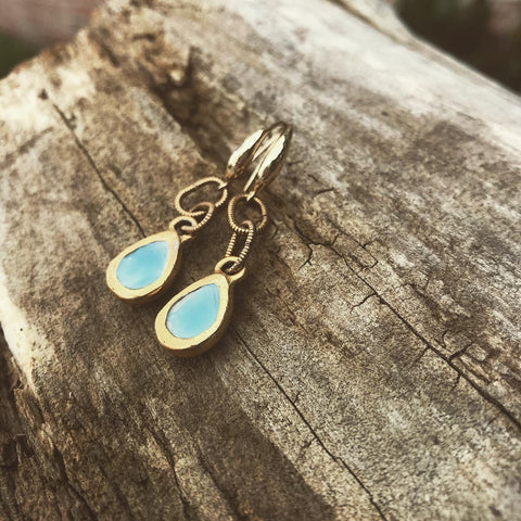 Gold framed small earrings with organic teardrop