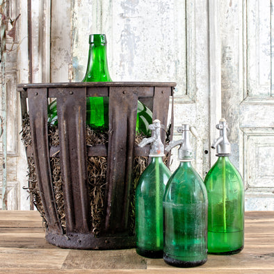 Green Demijohn in Metal Basket, France c. 1930