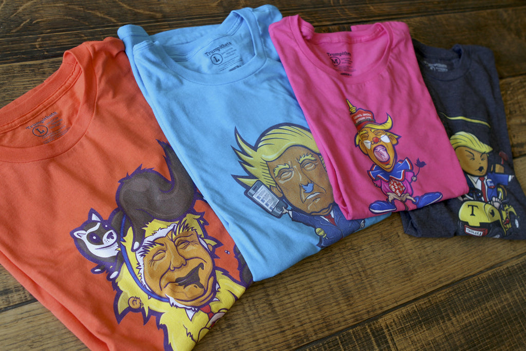 Four Trumpithets T-shirt Samples folded on a table