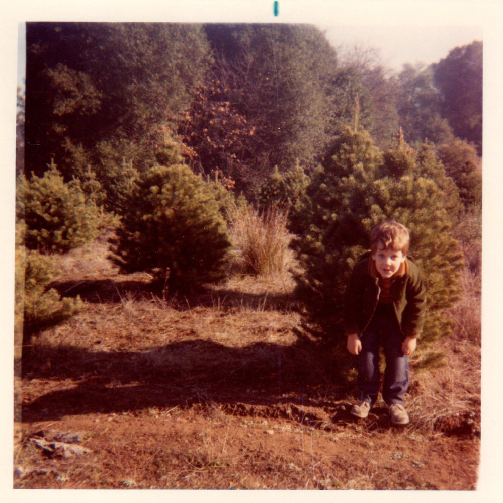 Jason, about age 5, mugging at the Christmas tree farm.