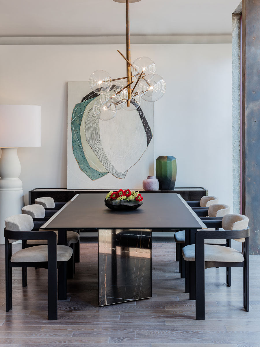 Gallotti&Radice Platinum Dining Table, Bolle Hanging Lamp and 0414 dining chair in Casa Design Boston Showroom