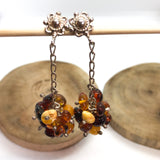 Cognac honey yellow butterscotch multicoloured amber long earrings set in sterling silver.