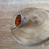 antique style silver and amber ring, amber is oval shaped