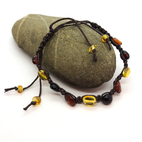 adjustable multicoloured amber bracelet set in brown cotton with oval amber beads