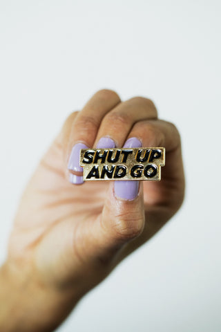 Shut Up And Go Gold Enamel Pin