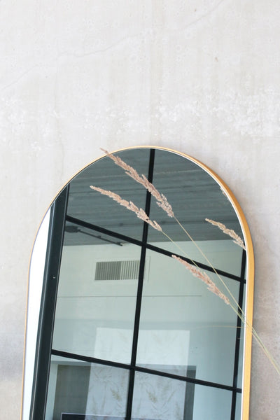 arch wall mirror brass