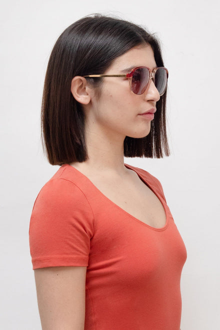 Edie is wearing the Webster Sunglasses in Orange Gold