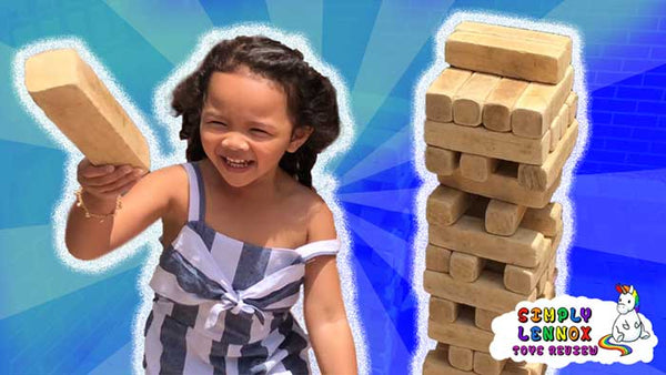 Playing Jenga Blocks in Trendy and Fashionable Clothes