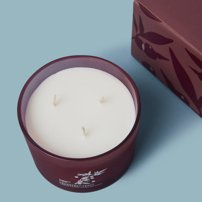 Cranberry soy wax candle in a glass vessel