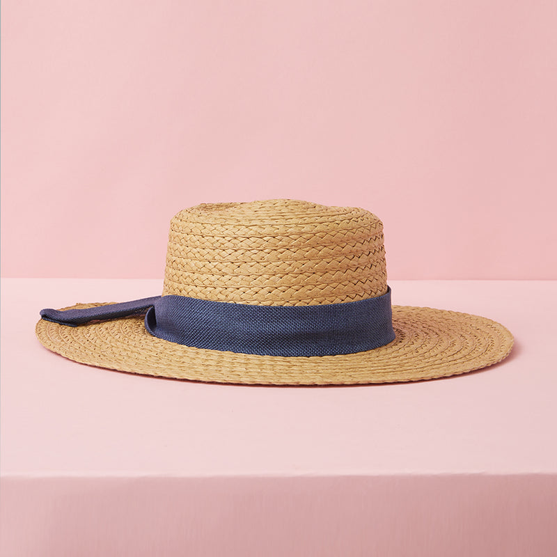 Straw hat with a navy bow