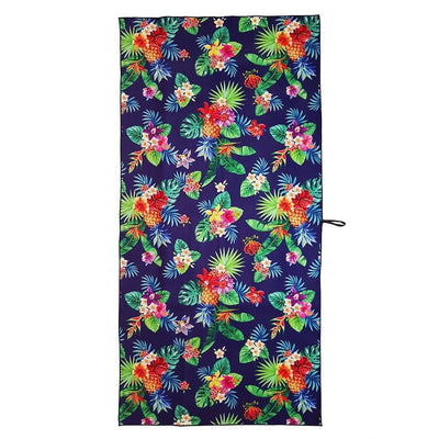 Kokomo - beach towel with pineapples and dark blue background