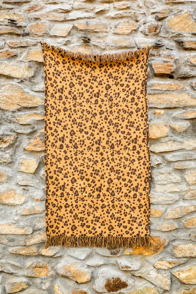 A Cotton Handloom Dhurrie With Leopard Rosettes