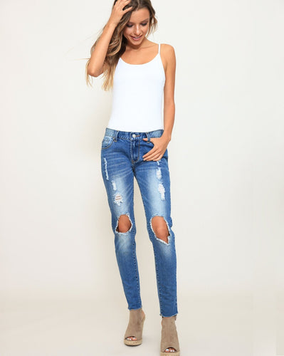 ripped denim mid rise skinny jeans