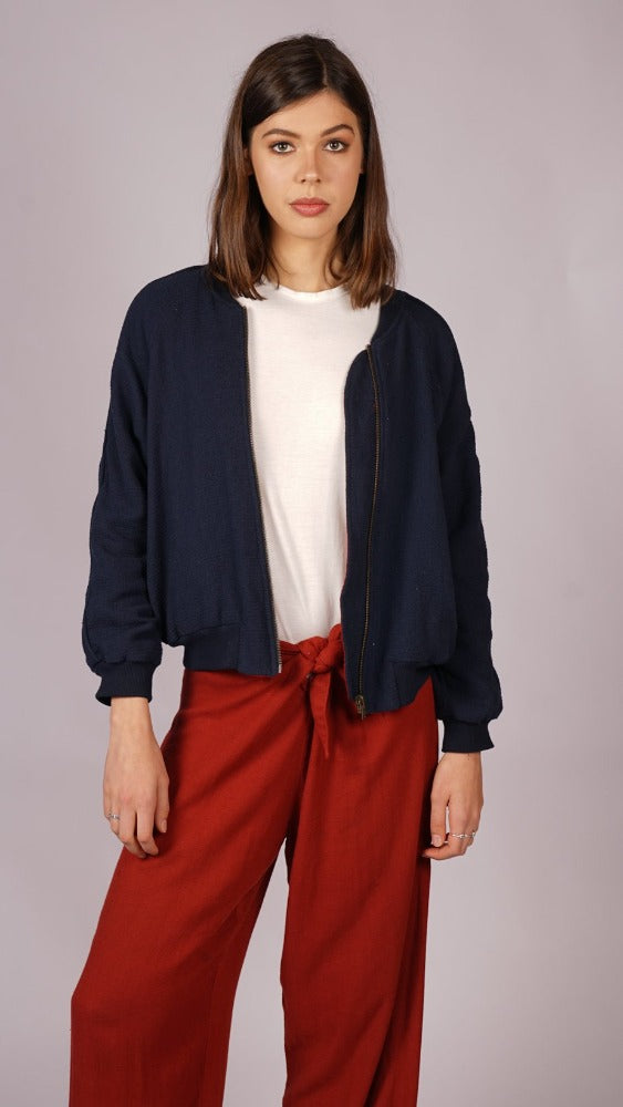 Reversible long sleeve bomber jacket in red and navy. Comfortable and stylish with pockets. Double layered warm bomber jacket made from linen and cotton. Trans seasonal, sustainable and ethically made. Multifunctional bomber jacket designed in Australia.