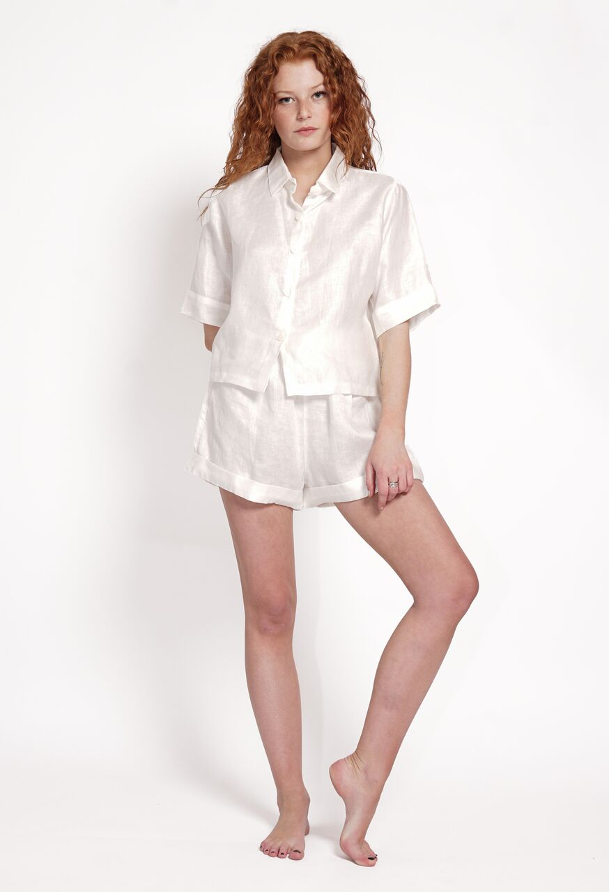 Drawstring shorts with tie. Cuffed hem. Crisp white linen. Wear shorts high waisted or on the hips. Women's shorts made from 100% linen. Sustainable and ethically made beach to bar wears designed in Australia. Stylish and comfortable linen shorts made from natural fibres.