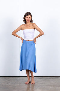 Floaty full blue linen skirt with a narrow waistband centre back zipper. French blue linen skirt. Midi skirt in linen rayon blend. Comfortable and stylish linen skirt. Sustainably driven beach to bar wear designed in Australia.