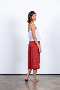 Sustainable and eco-friendly palazzo style linen culotte with side seam pockets and patch pockets on the back. 100% linen pant in red. Cropped 3/4 length pant. Red culottes with centre back zipper. Designed in Australia. Trans seasonal comfortable culottes made from natural fibres, easy to style. Beach to bar wear.