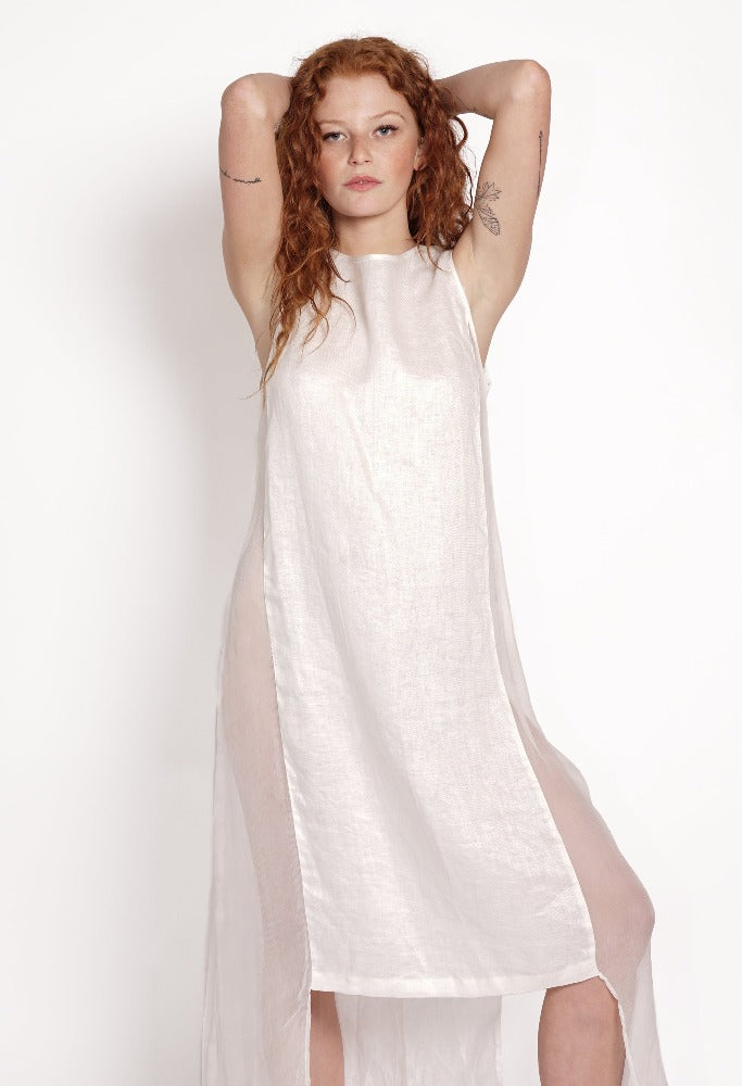 Whimsicle white linen summer dress. Sustainable linen and silk dress made from natural fibres. Designed in Australia. Stylish sheer linen shift dress. Light and comfortable to wear loose-fitting linen dress. Ethically made slow fashion. Beach to bar wear.