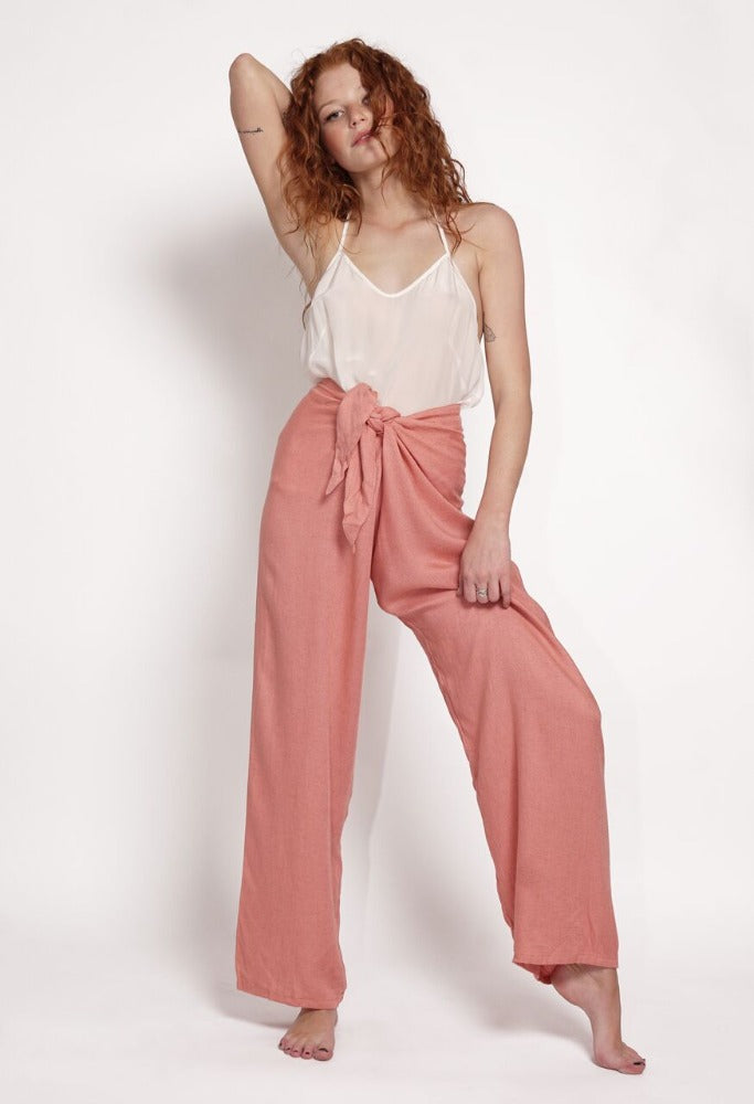 Straight cut loose fit pant. Pink tie pant. Hand-dyed in fresh earthy pink tones. Super soft and comfortable pant with adjustable waistband. Casual pant made in linen rayon blend  This trans-seasonal pant is perfect for travel. Sustainably driven beach to bar wear.