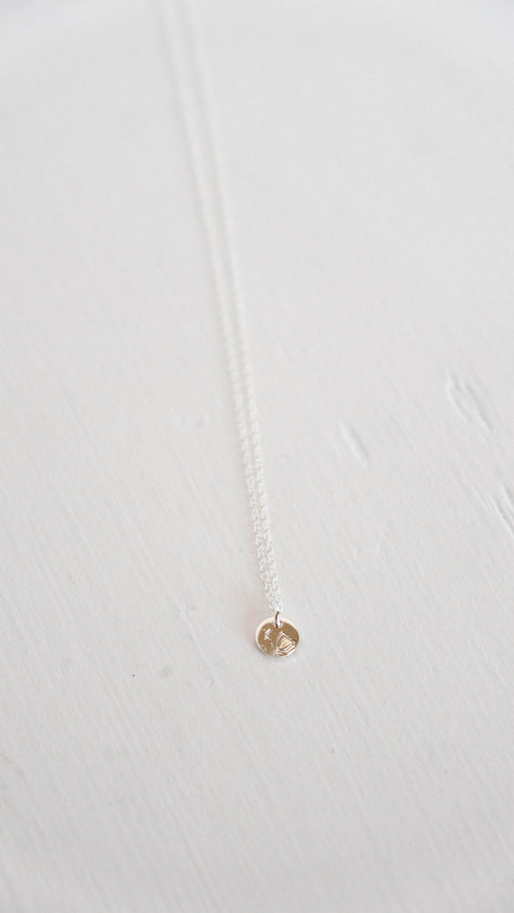 Silver flower bud initial coin necklace