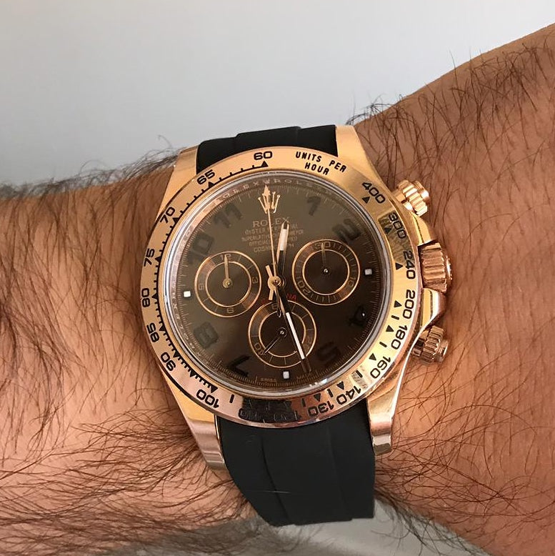 Gold Rolex Daytona black rubber strap