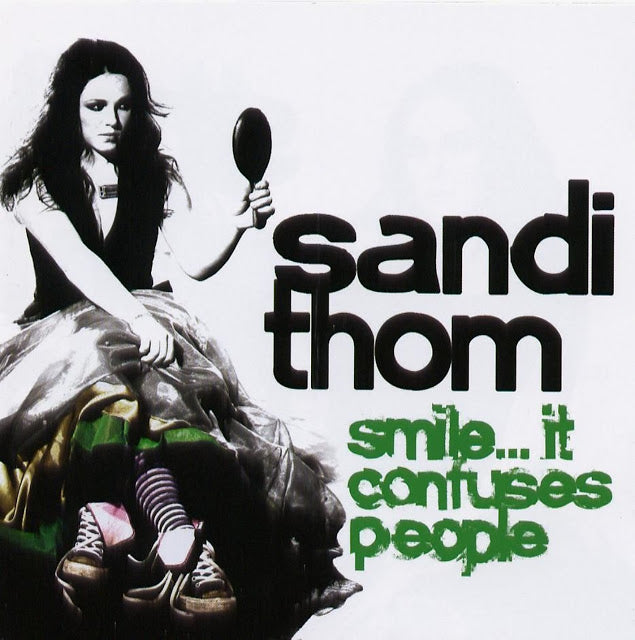 Smile it confuses people (signed by Sandi)