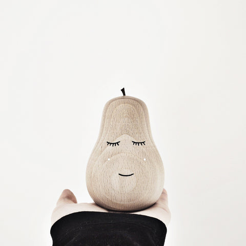 neutral childrens room decor wooden pear