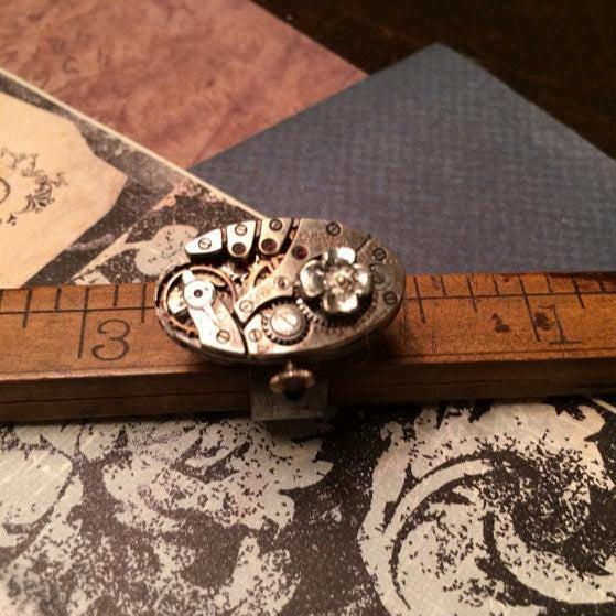 Vintage Bulova Oval Watch Movement Ring with Antique Flower Charm - The Victorian Magpie