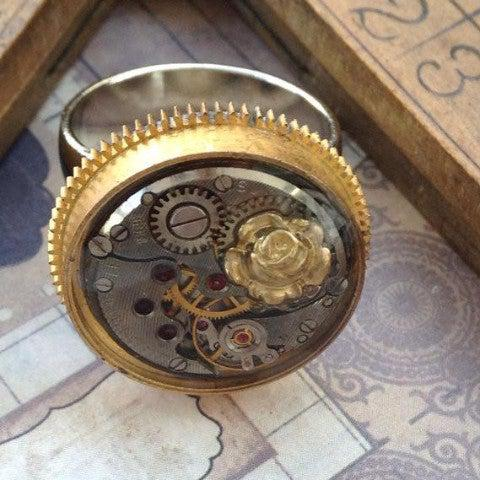 Vintage Watch Movement Ring in Gold Mainspring Case with Rose Charm - The Victorian Magpie