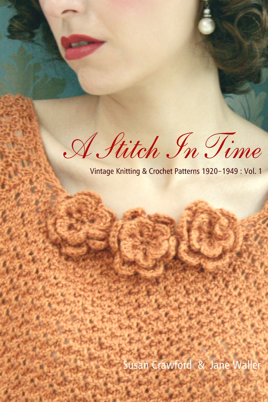 Cover of the book A Stitch in Time volume 1. An image of a woman from the nose down. She wears a peach coloured top with flower embellishments. She has brown curled hair, pearl earrings and red lipstick.