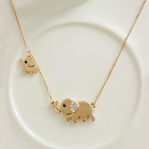 Vncys gold elephant necklace vncys boutique vncys gold elephant necklace aloadofball Gallery