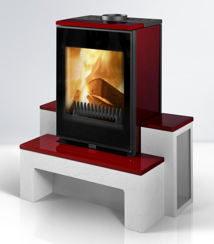 Image of Kimberley stove (red in colour) with fire lighting