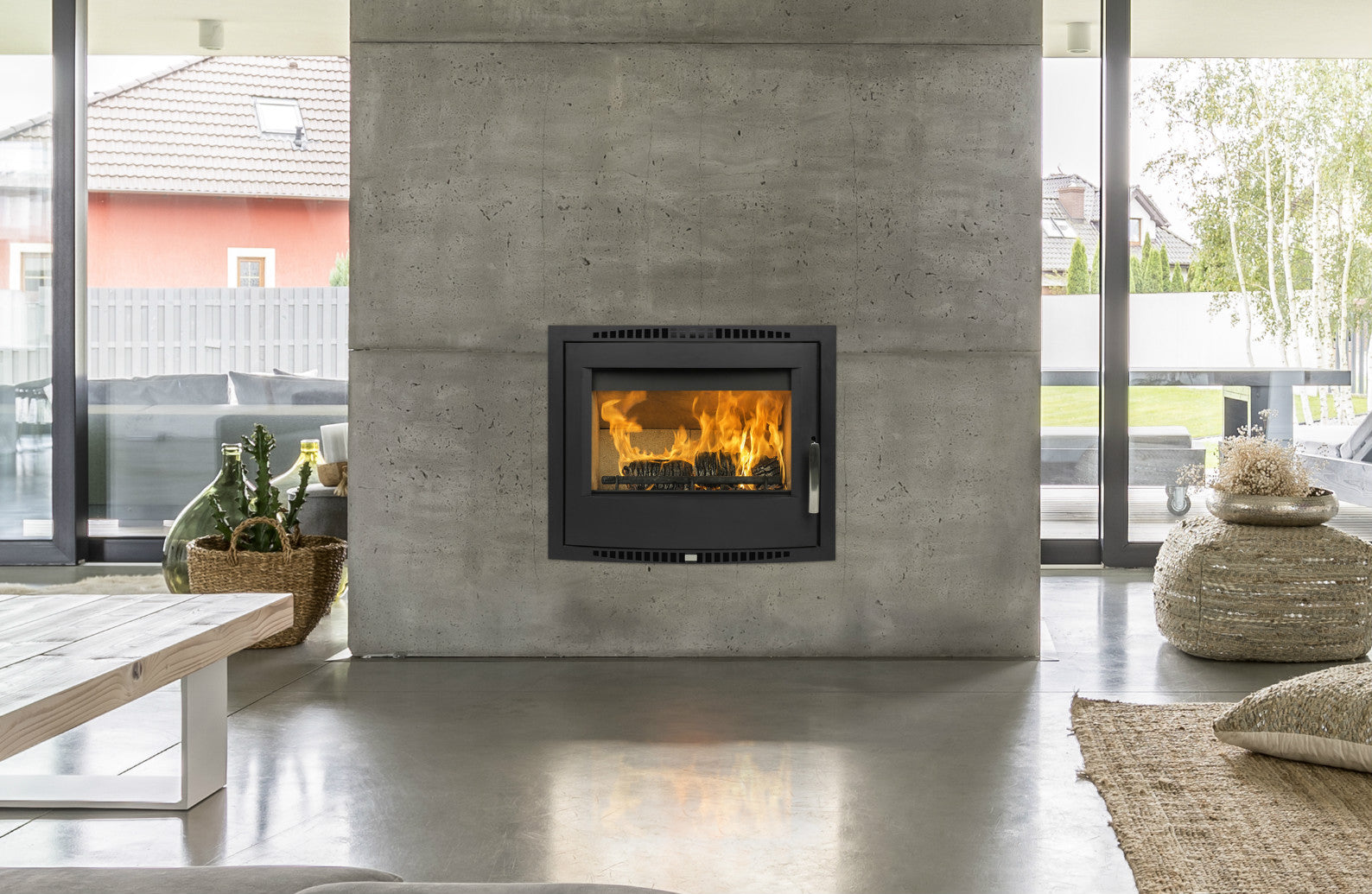 A Shannon Passive Eco stove shown in an airtight house boosts high efficiency, heat output 10 kW and contemporary look.