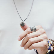 Goro's Style Embossed Thunderbird Disc Titanium Necklace