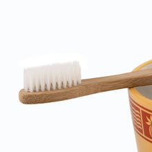 Eco-Friendly Giving Brush