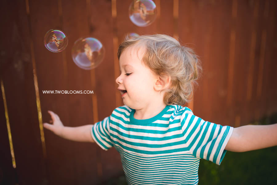 toddler playing with bubbles-4