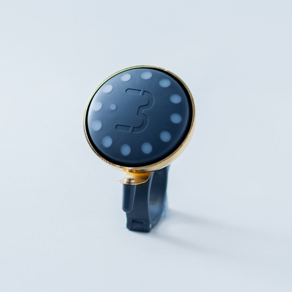 Charcoal Blubel navigation device with a matching bell mount in gold tone