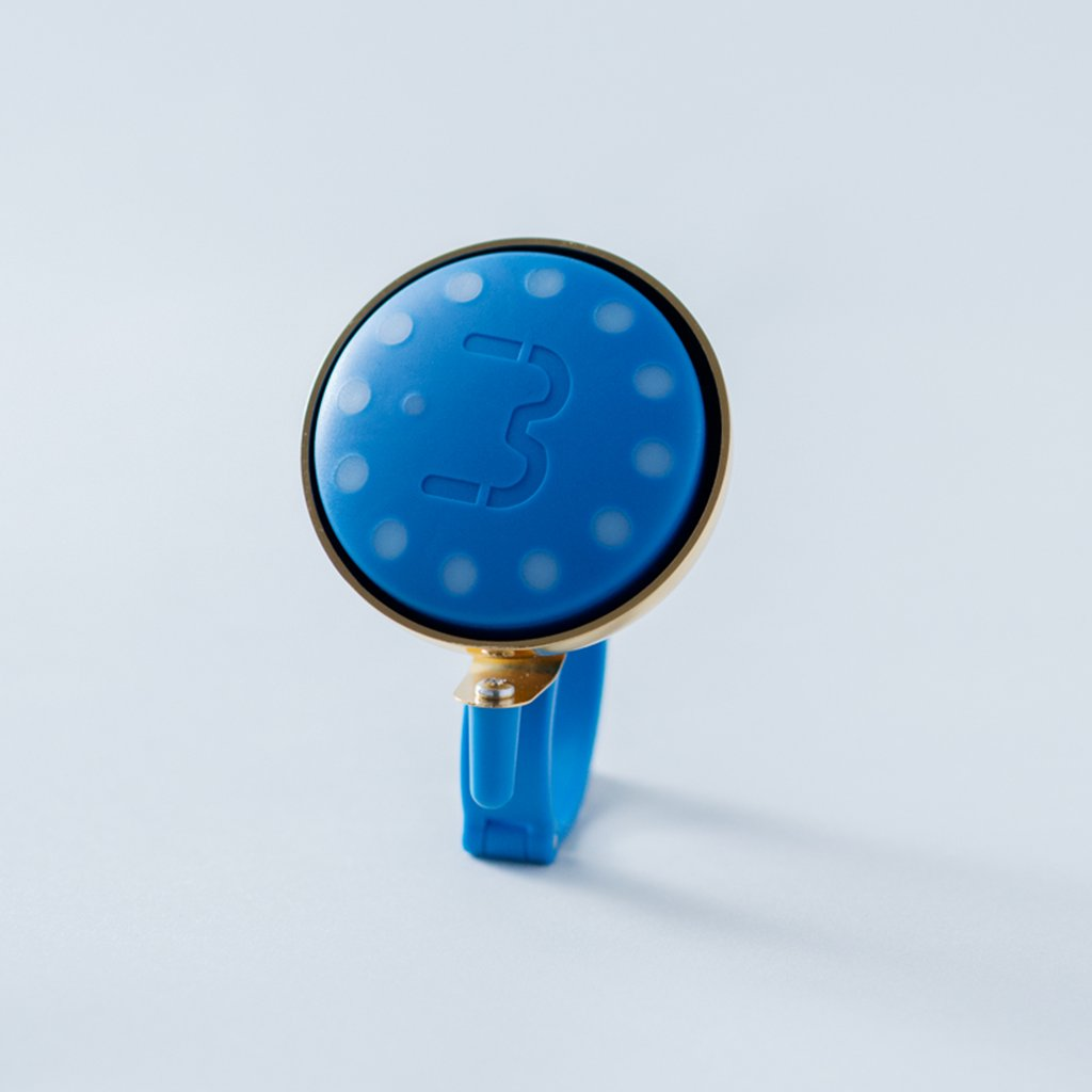 Indigo Blubel navigation device with a matching bell mount in gold tone
