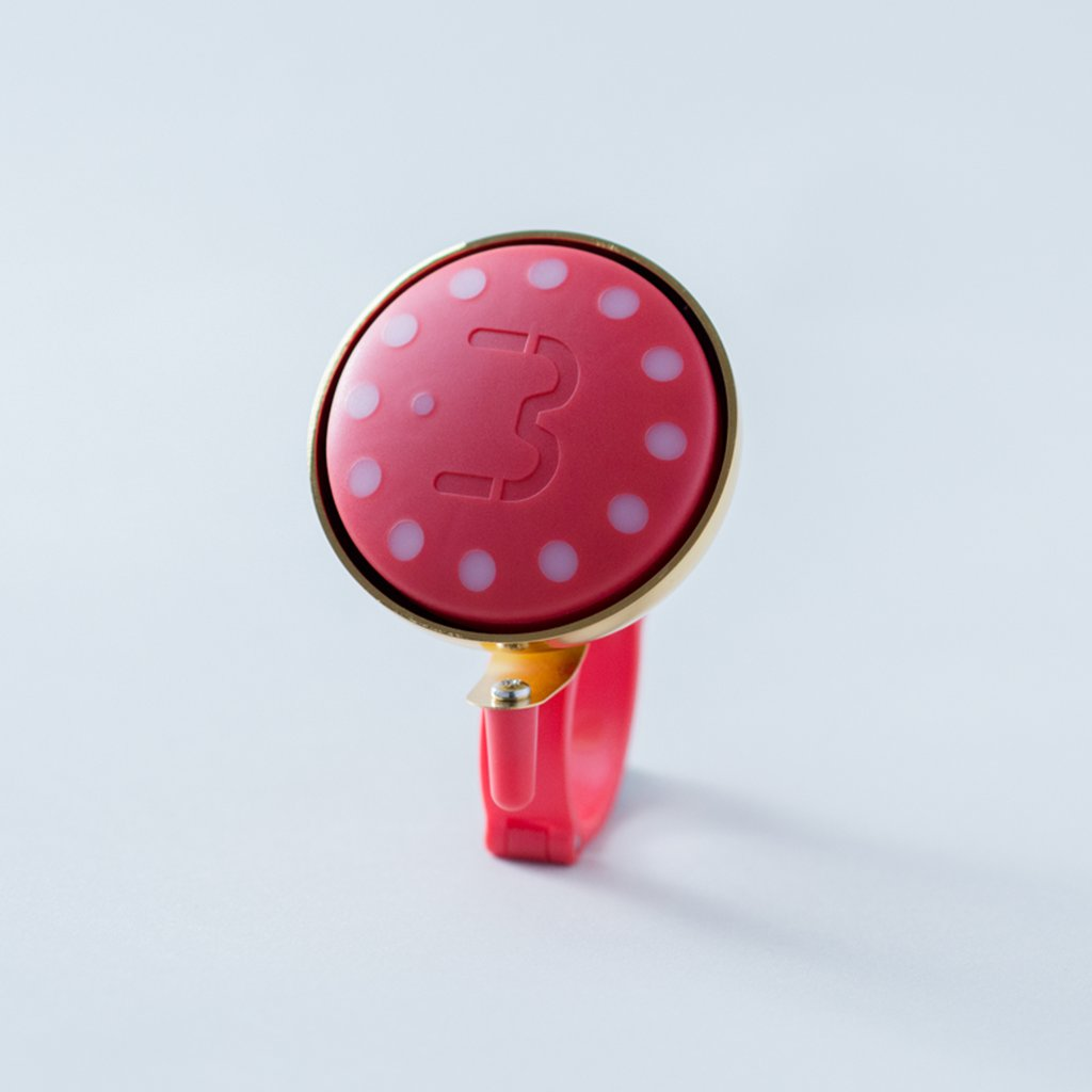 Ruby Blubel navigation device with a matching bell mount in gold tone