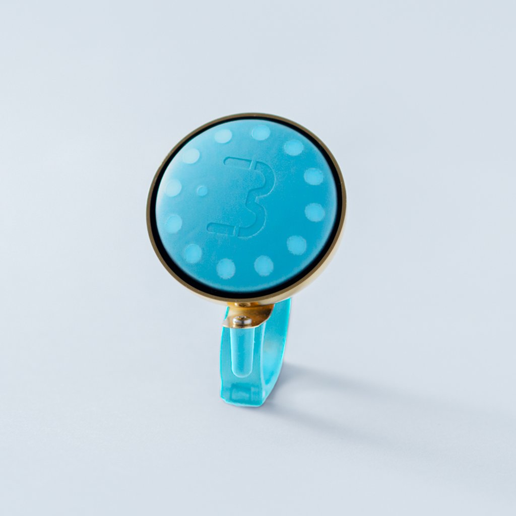 Seafoam Blubel navigation device with a matching bell mount in gold tone
